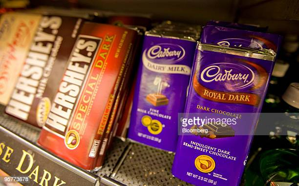 Hershey Co Hershey's brand and Cadbury Plc brand chocolate bars sit on display in a supermarket in New York US on Thursday Jan 14 2010 Hershey Co...