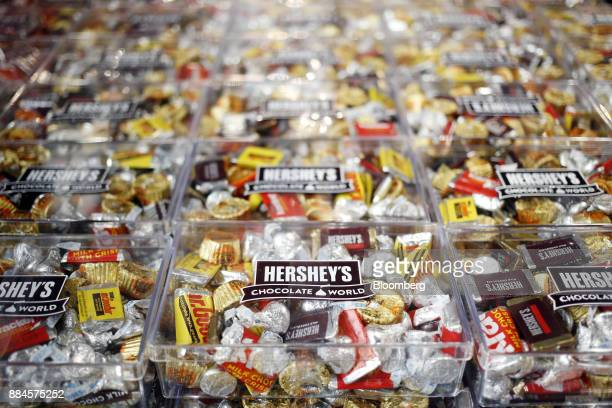 Hershey Co miniature candies are displayed for sale inside of the company's Chocolate World visitor center in Hershey Pennsylvania US on Tuesday Nov...