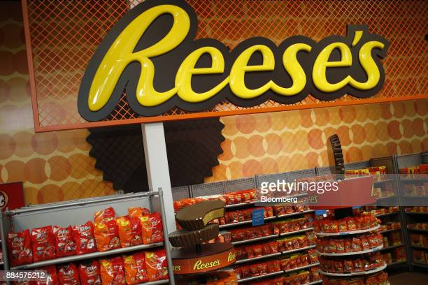 Hershey Co Reese's peanut butter chocolate candies are displayed for sale inside of the company's Chocolate World visitor center in Hershey...