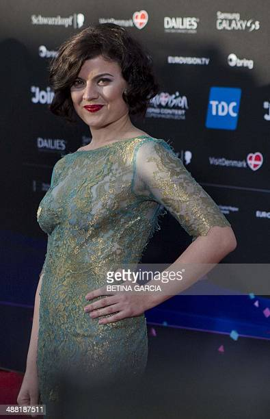 Hersi Matmuja representing Albania at the Eurovision Song Contest with the song 'One Night's Anger' poses on the red carpet during an opening...