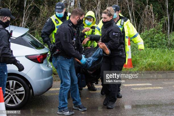 Hertfordshire Police officers arrest an anti-HS2 activist after invoking Section 14 of the Public Order Act 1986 to clear an area outside an entrance...