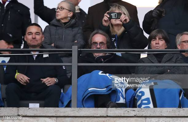 Hertha Berlin investor Lars Windhorst and German national football team coach Joachim Loew watch the German first division Bundesliga football match...