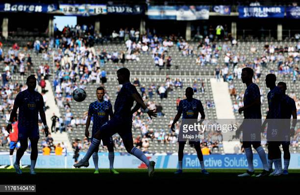Hertha Berlin players warm up prior to the Bundesliga match between Hertha BSC and SC Paderborn 07 at Olympiastadion on September 21 2019 in Berlin...