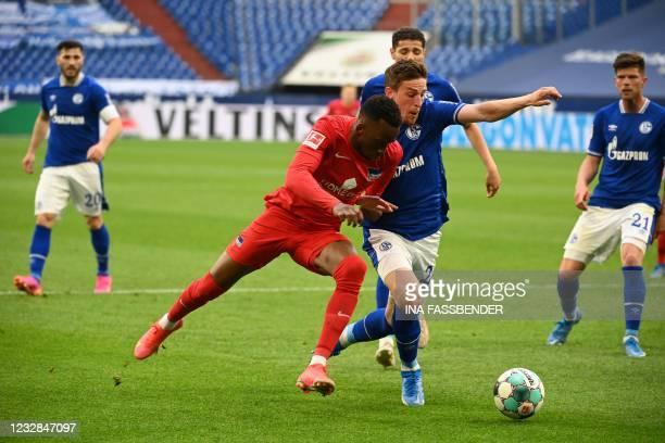 Hertha Berlin's Belgian forward Dodi Lukebakio and Schalke's German defender Bastian Oczipka vie for the ball during the German first division...