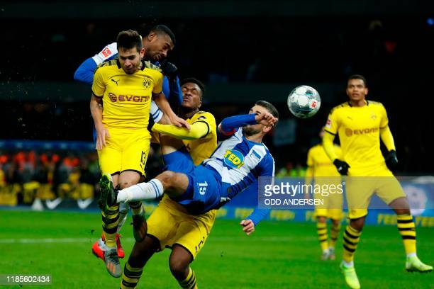 Hertha Berlin's Bosnian forward Vedad Ibisevic and Hertha Berlin's Ivorian forward Salomon Kalou vie with Dortmund's Portuguese defender Raphael...