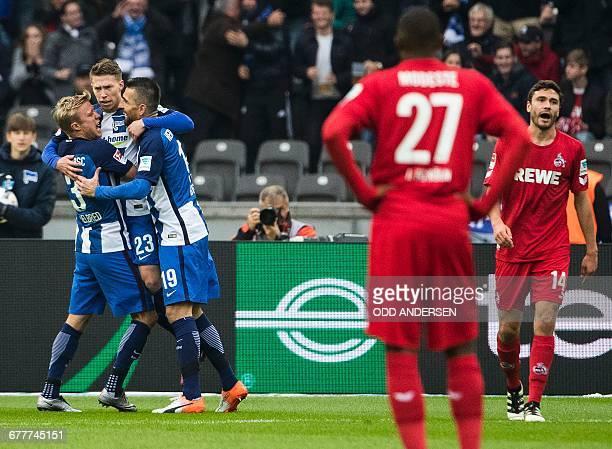 Hertha Berlin's Bosnian forward Vedad Ibisevic celebrates scoring the opening goal with team mates Hertha Berlin's Norwegian midfielder Per Skjelbred...