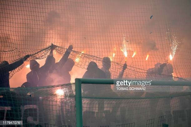Hertha Berlin's fans light flares during the German first division Bundesliga football match between FC Union Berlin and Hertha Berlin on November 2...