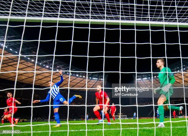 Hertha Berlin's forward Davie Selke kicks the ball to score during the UEFA Europa League football match between Hertha BSC Berlin and FC Zorya...