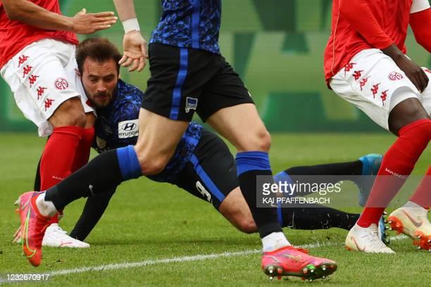 Hertha Berlin's French midfielder Lucas Tousart hits his head during the German first division Bundesliga football match between Mainz 05 vs Hertha...