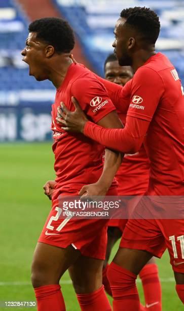 Hertha Berlin's German forward Jessic Ngankam celebrates the 1-2 during the German first division Bundesliga football match FC Schalke 04 v Hertha...