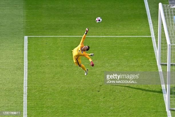 Hertha Berlin's German goalkeeper Alexander Schwolow makes a save during the German first division Bundesliga football match Hertha Berlin v Arminia...