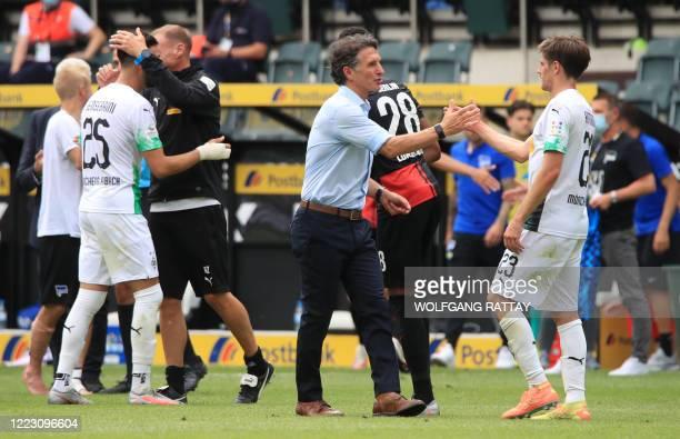 Hertha Berlin's German head coach Bruno Labbadia greets with Moenchengladbach's German midfielder Jonas Hofmann at the end of the German first...