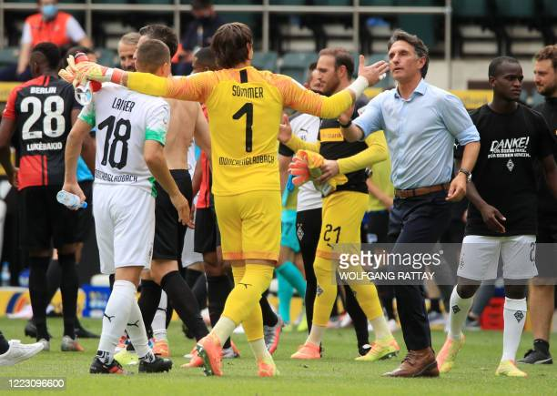 Hertha Berlin's German head coach Bruno Labbadia greets with Moenchengladbach's Swiss goalkeeper Yann Sommer at the end of the German first division...