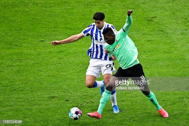 Hertha Berlin's German midfielder Sami Khedira and Moenchengladbach's Swiss forward Breel Embolo vie for the ball during the German first division...