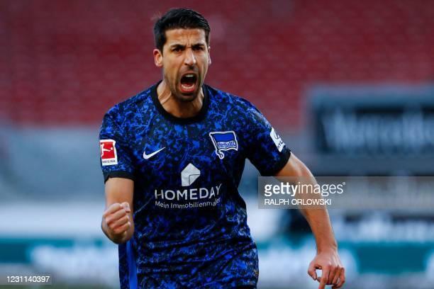 Hertha Berlin's German midfielder Sami Khedira celebrates after his teammate scored during the German first division Bundesliga football match...