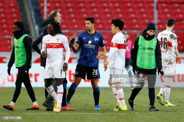 Hertha Berlin's German midfielder Sami Khedira shakes hands with Stuttgart's US coach Pellegrino Matarazzo after the German first division Bundesliga...