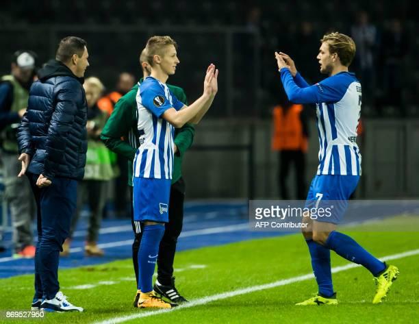 Hertha Berlin's Hungarian head coach Pal Dardai watches midfielder Alexander Esswein leaving the pitch during the UEFA Europa League football match...