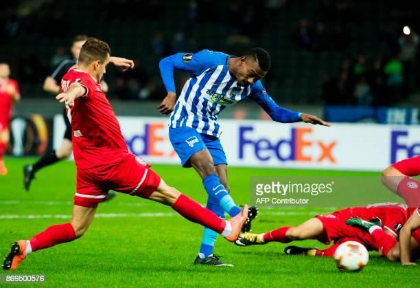 Hertha Berlin's Ivorian midfielder Salomon Kalou and Zorya's defender Artem Sukhotskiy vie for the ball during the UEFA Europa League football match...