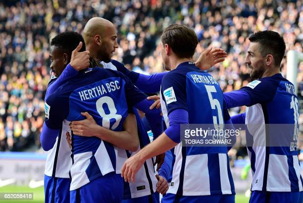 Hertha Berlin's Ivorian striker Salomon Kalou celebrates with teammates after scoring during the German First division Bundesliga football match of...