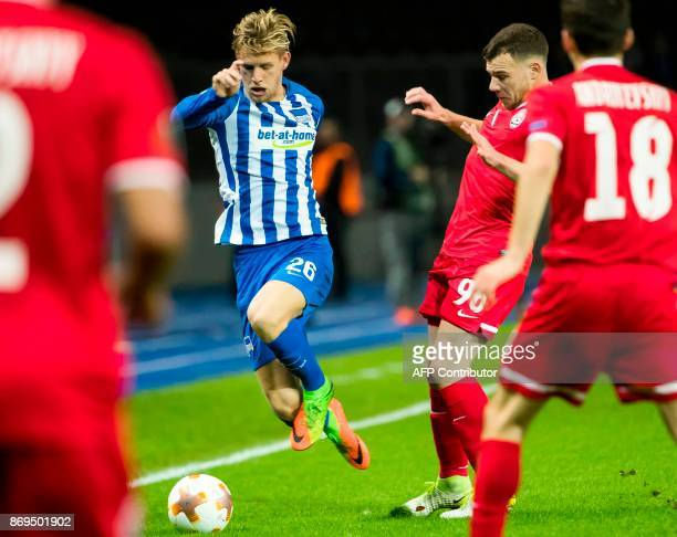 Hertha Berlin's midfielder Arne Maier and Zorya's Brazilian midfielder Silas vie for the ball during the UEFA Europa League football match between...