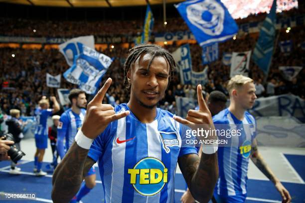 Hertha Berlin's players including Austrian midfielder Valentino Lazaro celebrate with their fans after the German first division Bundesliga football...