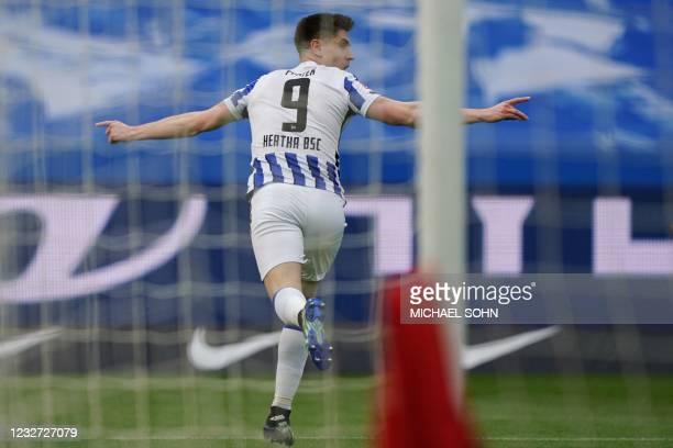 Hertha Berlin's Polish forward Krzysztof Piatek celebrates scoring the opening goal during the German first division Bundesliga football match Hertha...