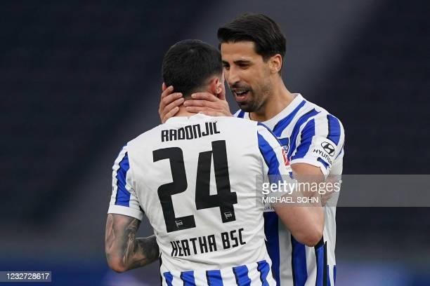 Hertha Berlin's Serbian midfielder Nemanja Radonjic celebrates scoring the 3-0 goal with his team-mate Hertha Berlin's German midfielder Sami Khedira...