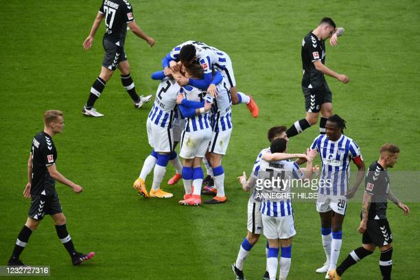 Hertha Berlin's Slovakian defender Peter Pekarik celebrates scoring the 2-0 goal with his teammates during the German first division Bundesliga...