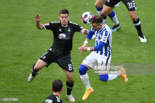 Hertha Berlin's Slovakian defender Peter Pekarik heads the ball past Freiburg's French midfielder Baptiste Santamaria to scores the 2-0 goal during...