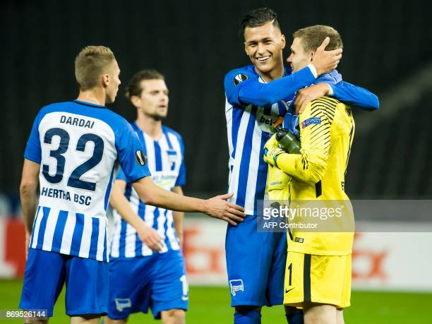 Hertha Berlin's two goals scorer forward Davie Selke celebrates at the final whistle with teammate goalkeeper Thomas Kraft at the end of the UEFA...