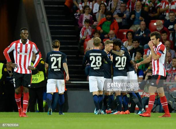Hertha BSC Berlin players celebrate the opening goal by German defender Maximilian Mittelstadt during the Europa League football match Athletic Club...