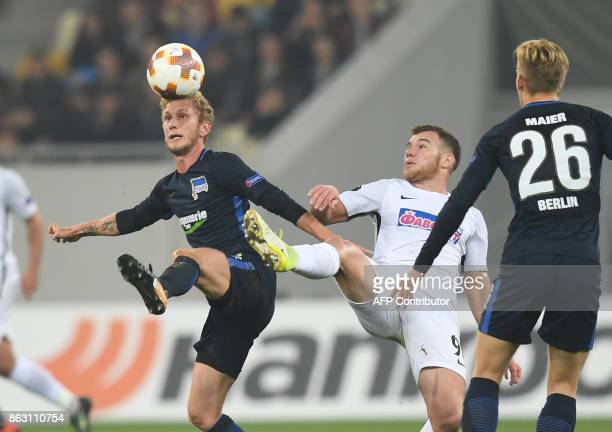Hertha BSC Berlin's Fabian Lustenberger and Arne Maier vies with Zorya's Maksym Lunyov during the UEFA Europa League Group J football match FC Zorya...