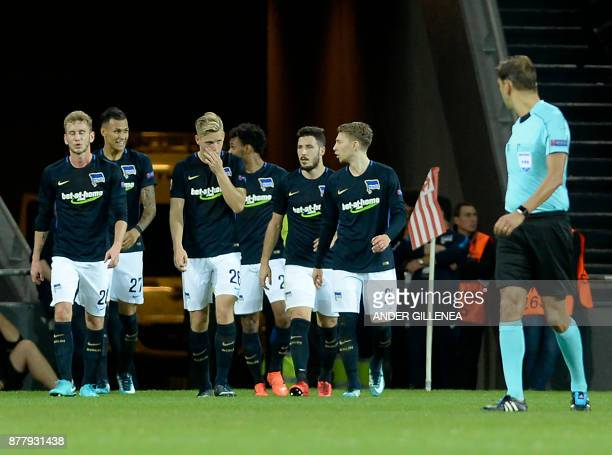 Hertha BSC Berlin's German forward Davie Selke smiles as he celebrates a goal with teammates during the Europa League football match Athletic Club...
