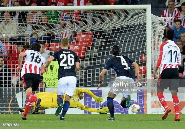 Hertha BSC Berlin's German goalkeeper Thomas Kraft concedes a second goal during the Europa League football match Athletic Club Bilbao vs Hertha BSC...