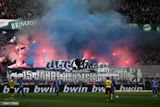 Hertha BSC fans set off pyrotechnics in support of their team during the Bundesliga match between Borussia Dortmund and Hertha BSC at Signal Iduna...