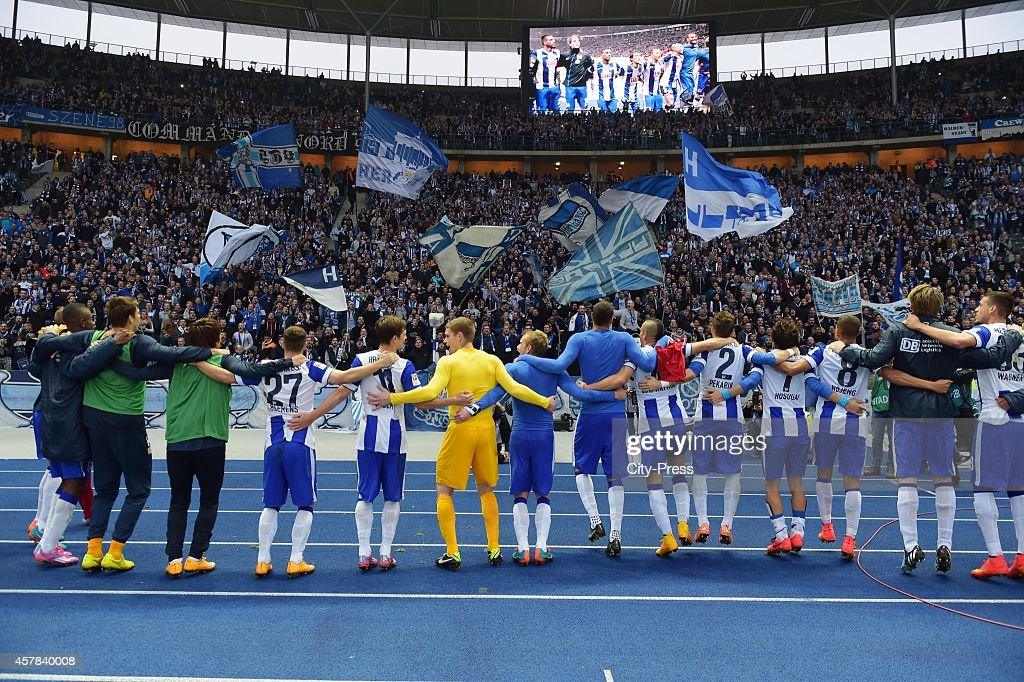 Hertha BSC players celebrate with the fans during the game between Hertha BSC and Hamburger SV on October 25, 2014 in Berlin, Germany.