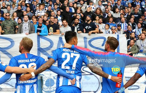 Hertha BSC players celebrate with their fans after victory in the Bundesliga match between Hertha BSC and Borussia Moenchengladbach at Olympiastadion...