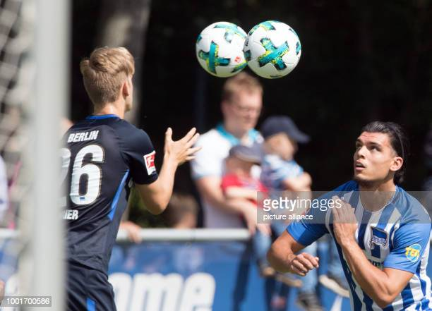 Hertha's Arne Maier throws balls to Karim Rekik at a training session in Berlin Germany 3 July 2017 The club is preparing for the next Bundesliga...