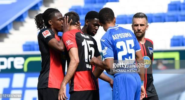 Hertha's Belgian defender Dedryck Boyata talks to teammate Serbian midfielder Marko Grujic during the German first division Bundesliga football match...