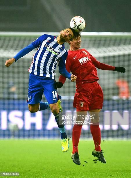 Hertha's Bosnian forward Vedad Ibisevic and Augsburg's South Korean defender JeongHo Hong vie during the German first division football Bundesliga...