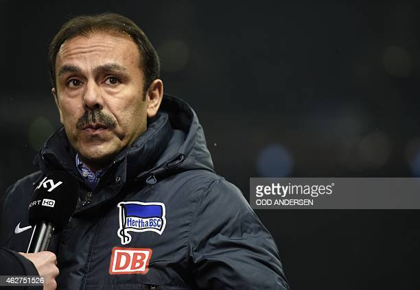 Hertha's Dutch head coach Jos Luhukay gives an interview ahead of the German first division Bundesliga football match Hertha BSC vs Bayer 04...