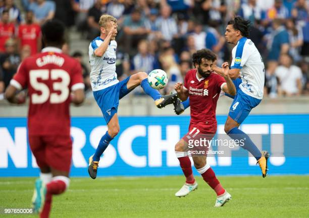 Hertha's Fabian Lustenberger and Karim Rekik vie for the ball against liverpool's Mohamed Salah during the international club friendly soccer match...