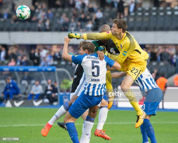 Hertha's goalkeeper Rune Jarstein and his colleague Niklas Stark in action against Schalke's Naldo during the German Bundesliga soccer match between...