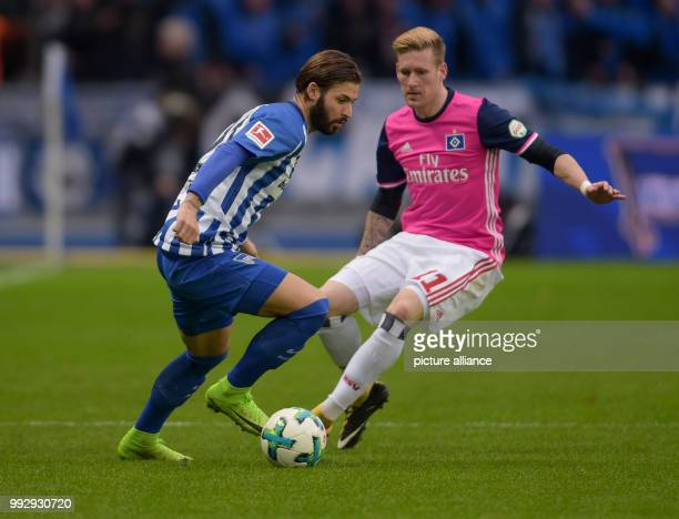 Hertha's Marvin Plattenhardt and Hamburg's Lewis Holtby vie for the ball during the Bundesliga soccer match between Hertha BSC and Hamburger SV in...