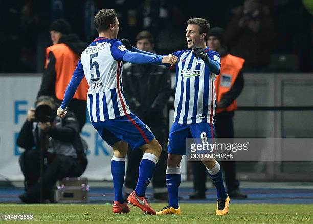Hertha's midfielder Niklas Stark celebrates scoring the 20 goal with his teammate Czech midfielder Vladimir Darida during the German first division...