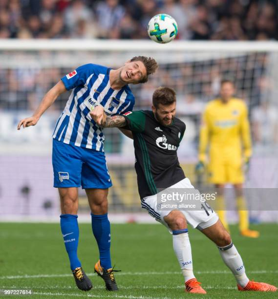 Hertha's Niklas Stark in action against Schalke's Guido Burgstaller during the German Bundesliga soccer match between Hertha BSC and FC Schalke 04 in...