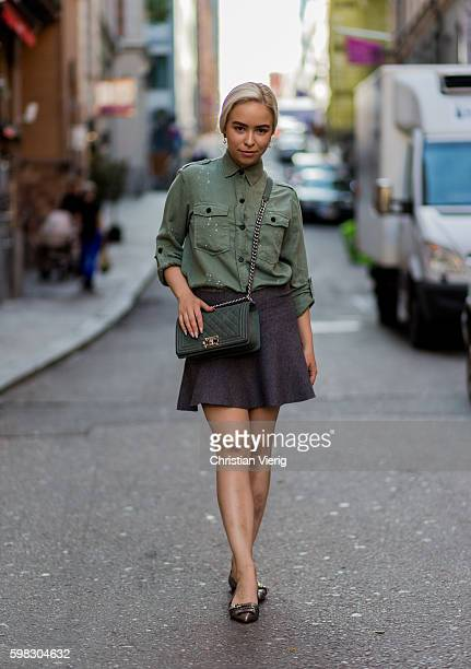 Hertta Viljanen wearing an olive military button shirt mini skirt Chanel bag and flats during the third day of the Stockholm Fashion Week...