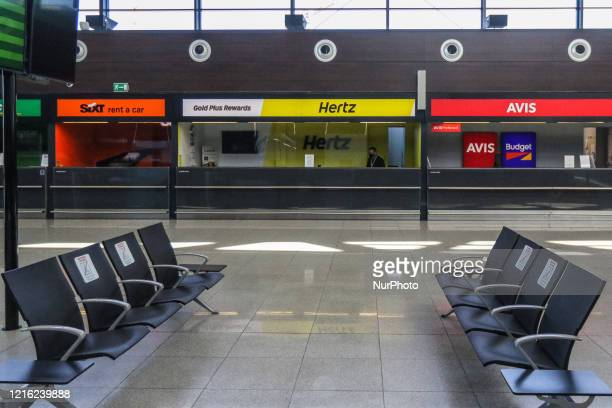 Hertz and Avis car rental stands are seen at the Gdansk Lech Walesa Airport in Gdansk, Poland on 29 May 2020
