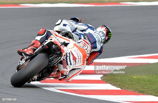 Hertz British MotoGP Motorbikes Race Day at Silverstone UK Jorge Lorenzo ESP Yamaha Factory Racing leads Marc Marquez ESP Repsol Honda during the...