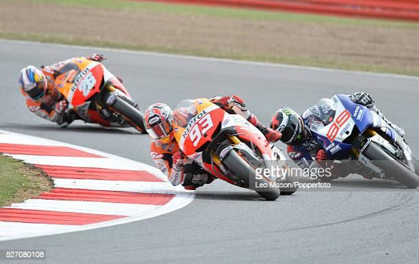 Hertz British MotoGP Motorbikes Race Day at Silverstone UK Marc Marquez ESP Repsol Honda leads Jorge Lorenzo ESP Yamaha Factory Racing & Dani Pedrosa...